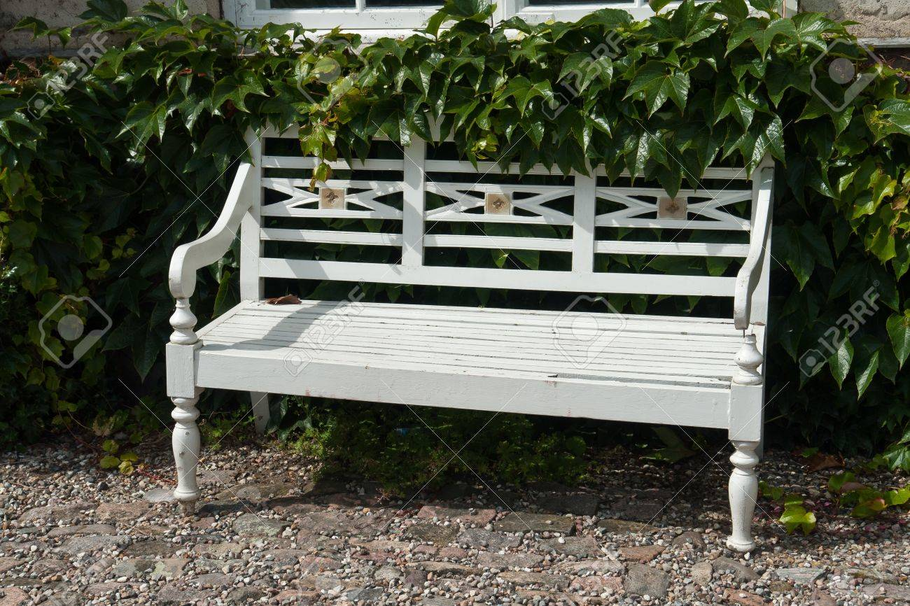 beautiful classical design park garden white wood bench seating  - beautiful classical design park garden white wood bench seating cornerstock photo