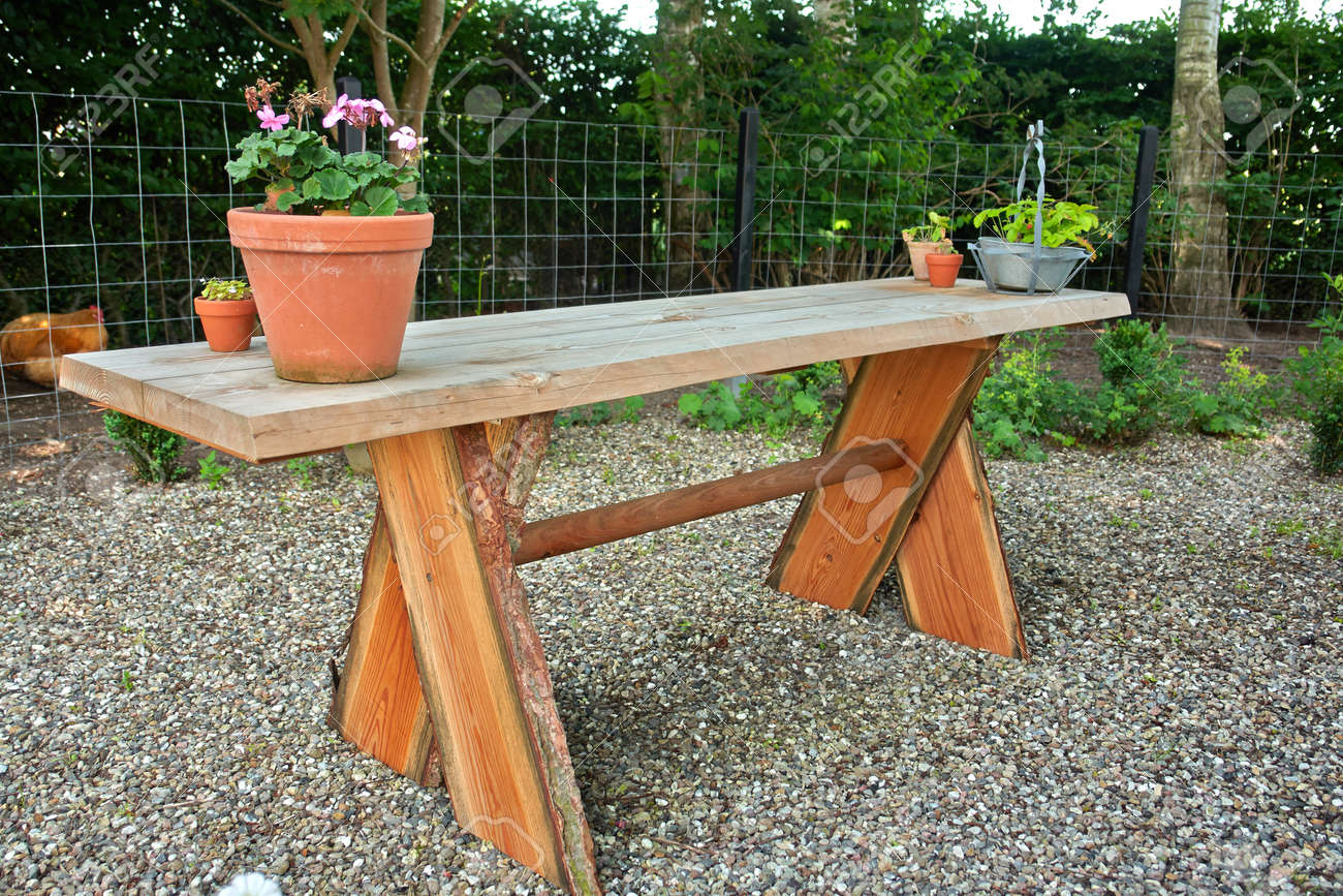 Beautiful hand made craft rustic wooden garden table with flowers