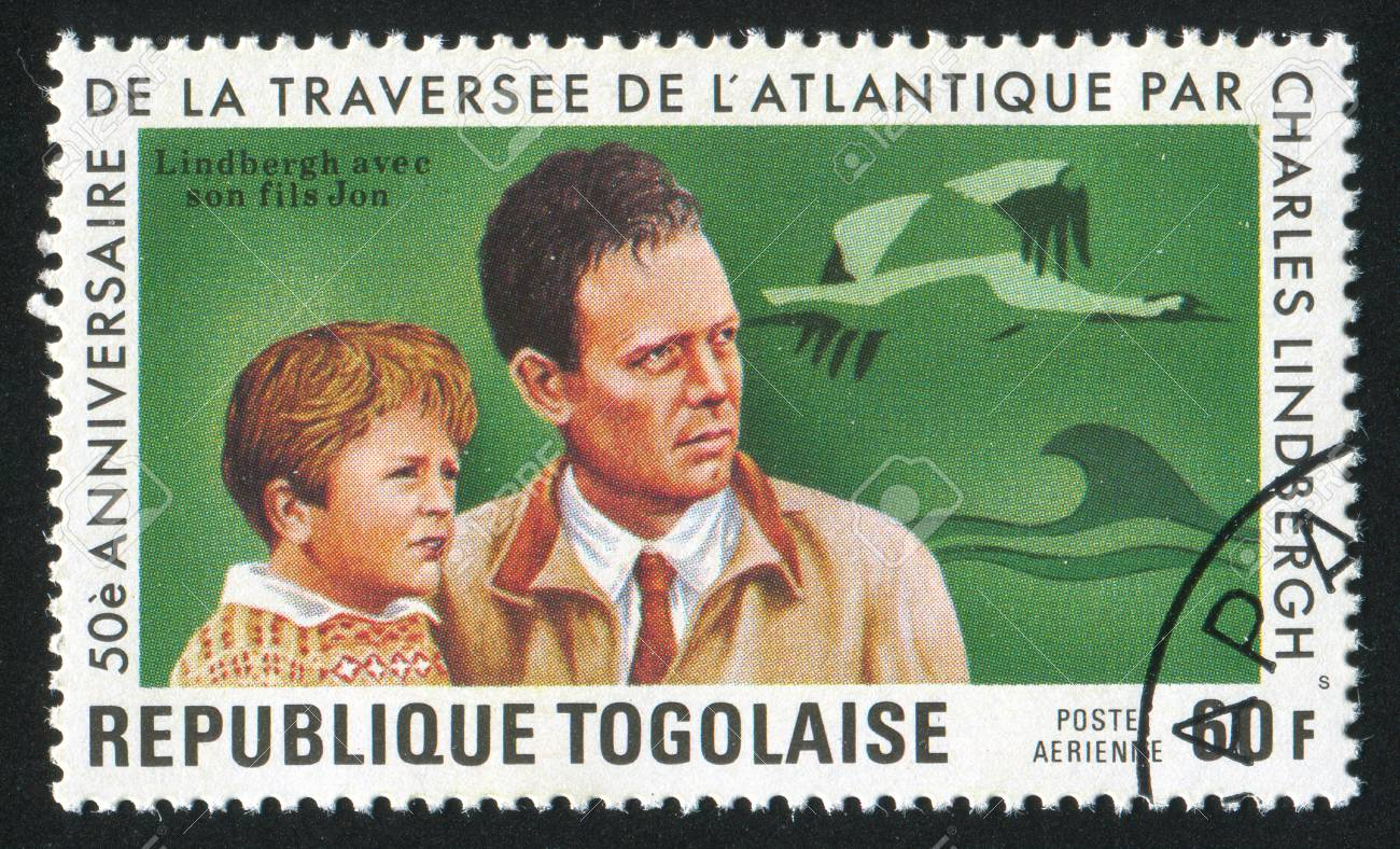 TOGO - CIRCA 1977: stamp printed by Togo, shows Lindbergh and son, birds, circa 1977 Stock Photo - 12354668