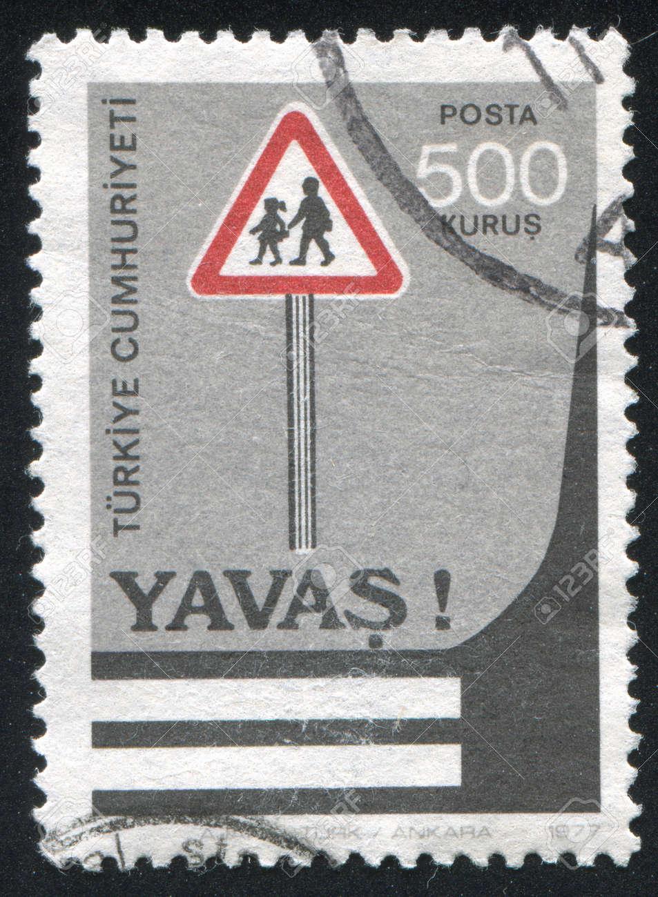 TURKEY - CIRCA 1977: stamp printed by Turkey, shows road safety, pedestrian crossing,  circa 1977 Stock Photo - 12999359