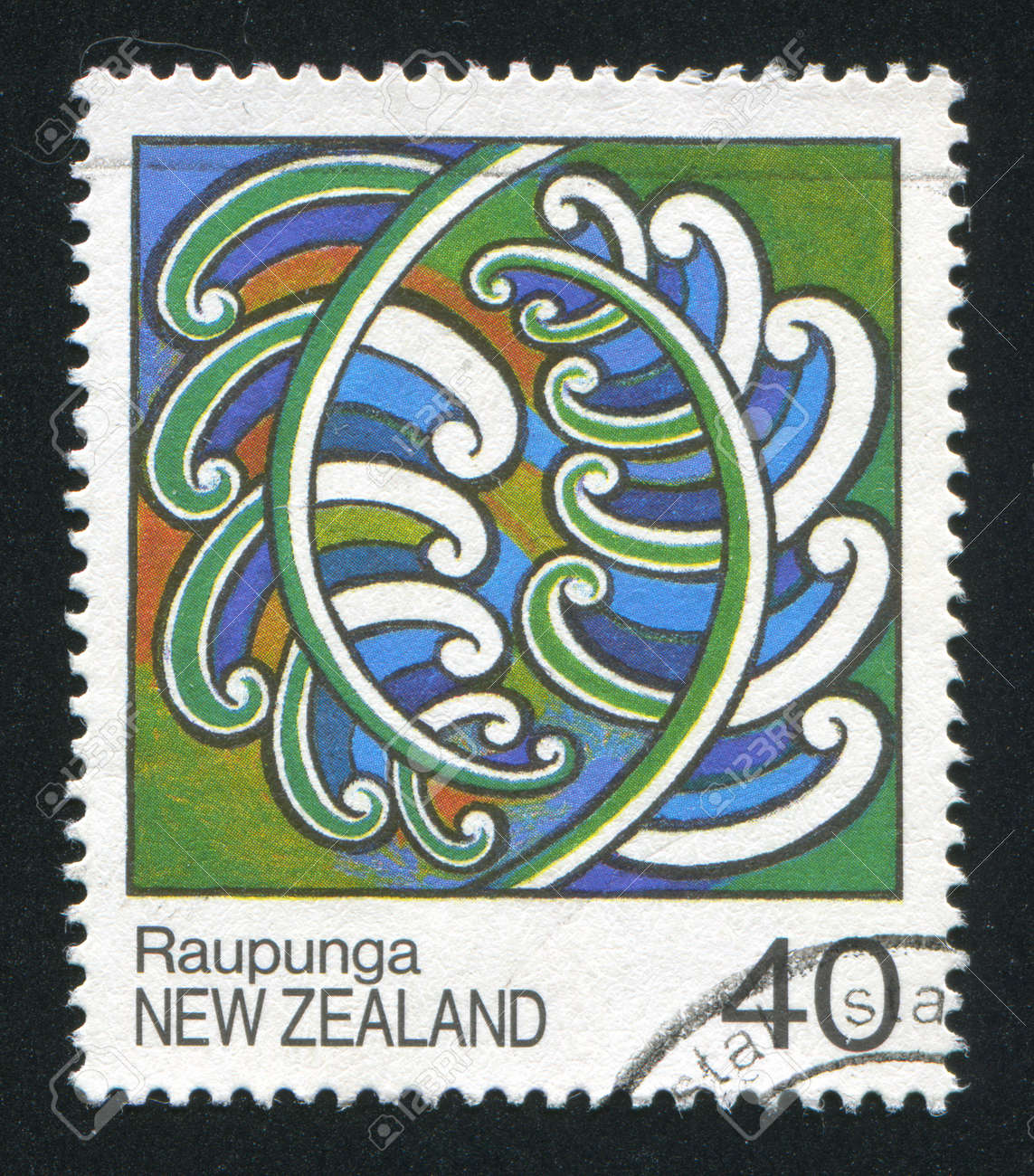 NEW ZEALAND - CIRCA 1988: stamp printed by New Zealand, shows Maori Rafter Paintings, Raupunga, circa 1988 Stock Photo - 13265892