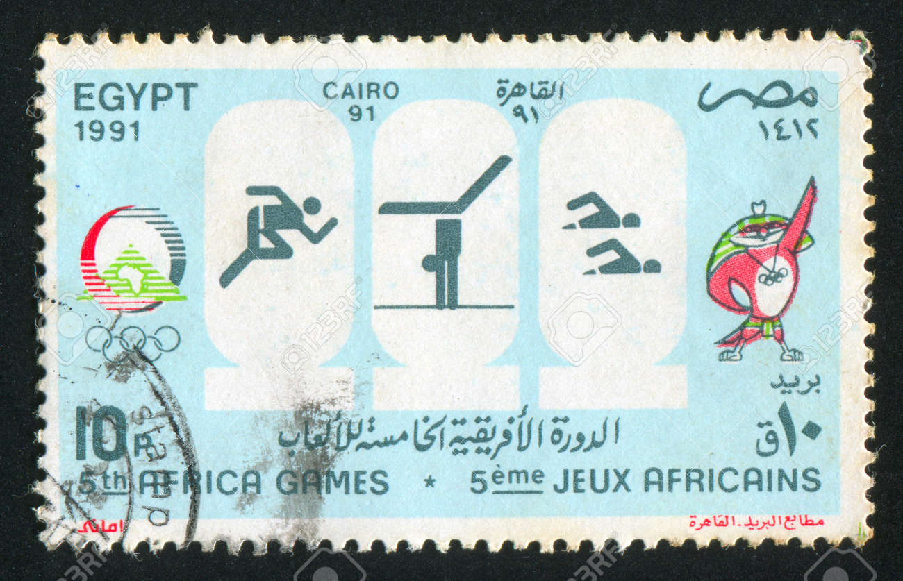 EGYPT - CIRCA 1991: stamp printed by Egypt, shows Mascot, Olympic emblem, circa 1991 Stock Photo - 13581148