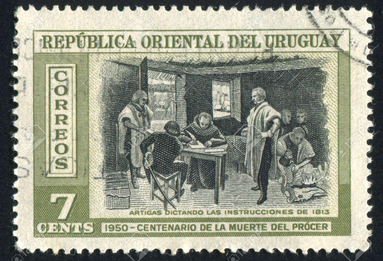 URUGUAY - CIRCA 1952: stamp printed by Uruguay, shows Artigas Dictating Instructions, circa 1952 Stock Photo - 14137228