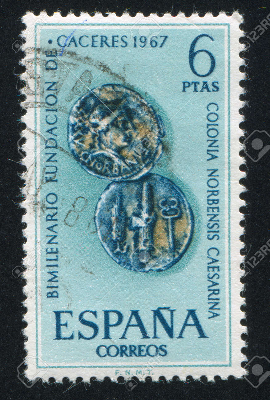 SPAIN - CIRCA 1967: stamp printed by Spain, shows Roman coins of Caceres, circa 1967 Stock Photo - 15621392