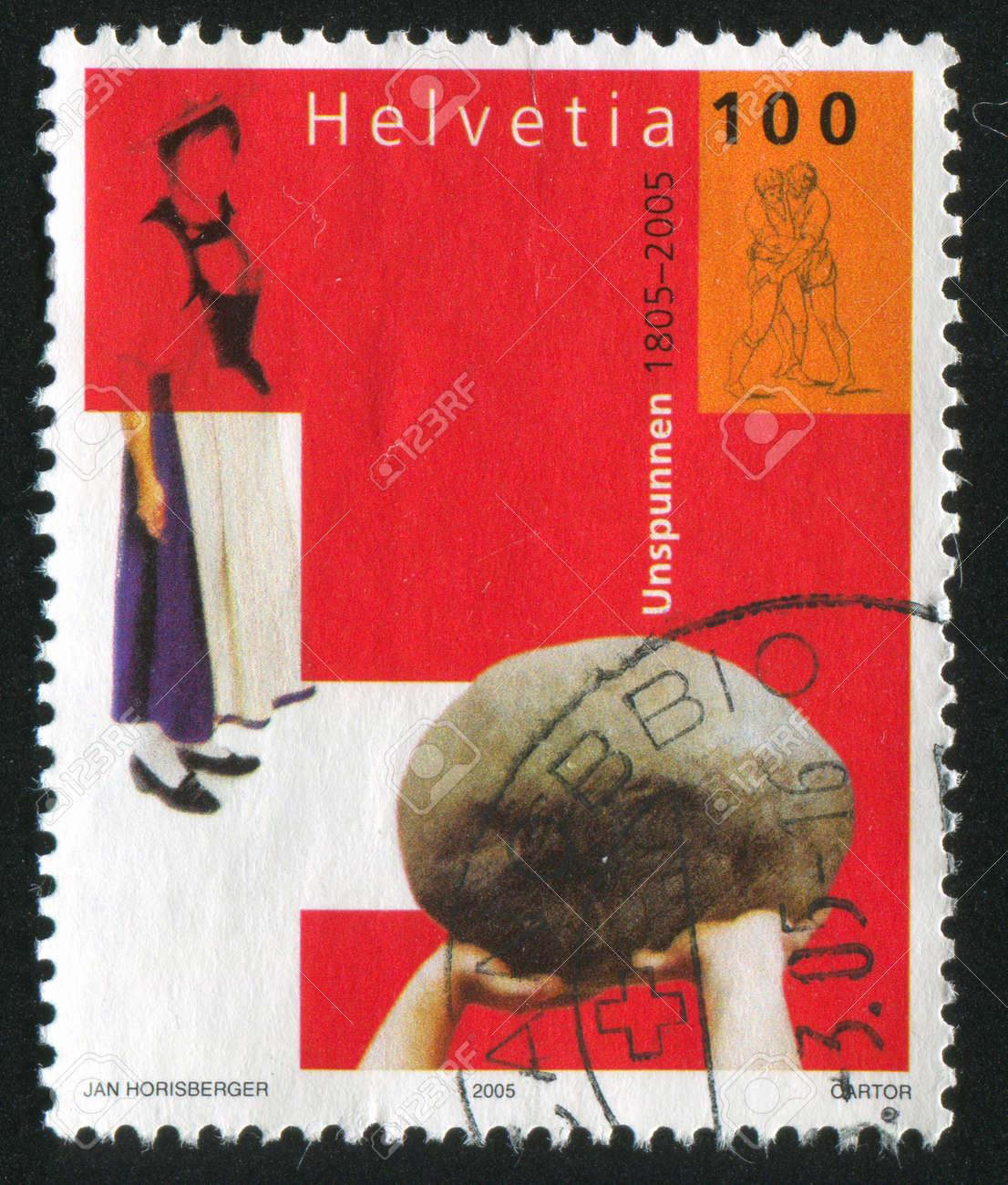 SWITZERLAND - CIRCA 2005: stamp printed by Switzerland, shows Unspunnen traditional costume and alpine herdsmans festival, circa 2005 Stock Photo - 17145279