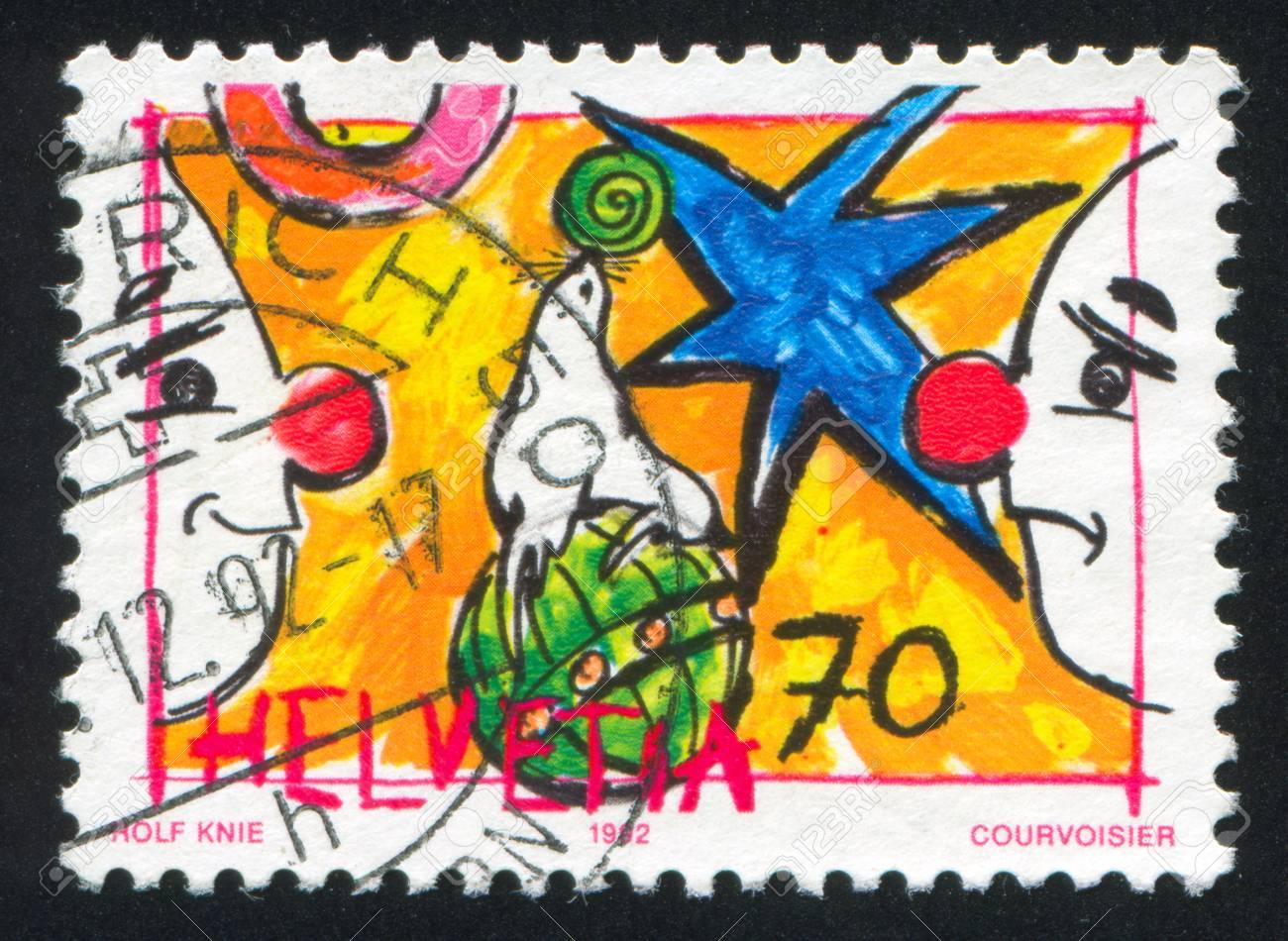 SWITZERLAND - CIRCA 1992: stamp printed by Switzerland, shows Sea lion and clowns, circa 1992 Stock Photo - 17837732