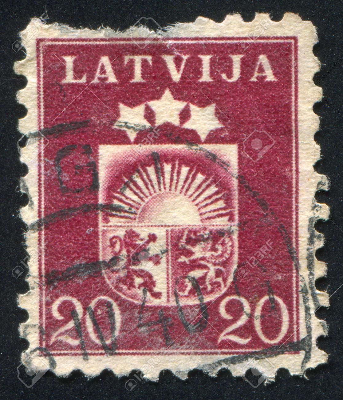 LATVIA - CIRCA 1919: stamp printed by Latvia, shows Arms, circa 1919 Stock Photo - 20527516