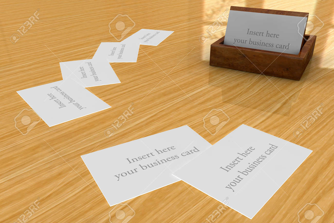 Wooden business cards holder on wooden desk with space for your stock photo wooden business cards holder on wooden desk with space for your own business cards colourmoves