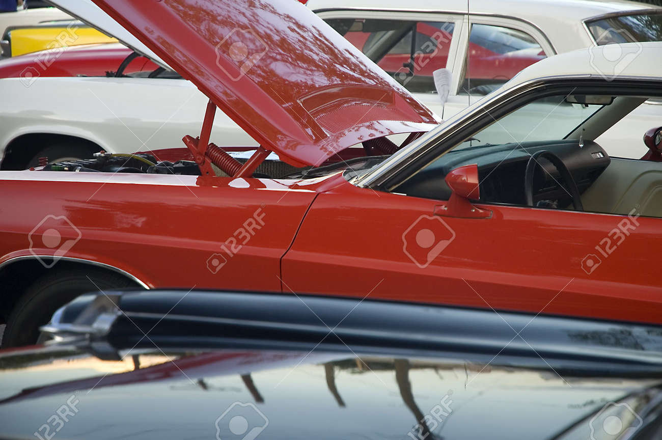 car show detail photo, several cars in picture, red car has his hood open Stock Photo - 3470216