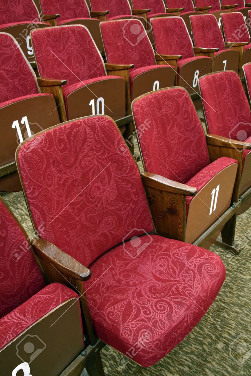 red theatre seats with white numbers, one seat unfolded Stock Photo - 4513075