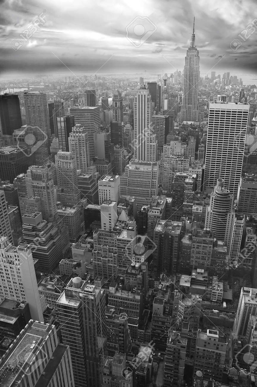 New york black and white vertical photo empire state building visible in distance stock photo