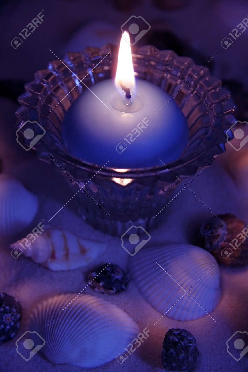 blue purple candle light with sand decoration Stock Photo - 8428502