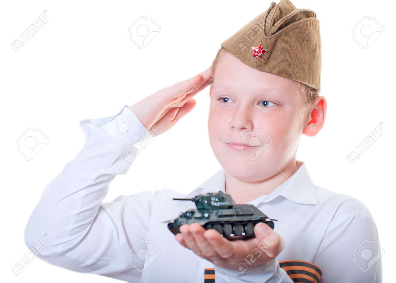 The boy is holding a plasticine model of the tank Stock Photo - 13265576