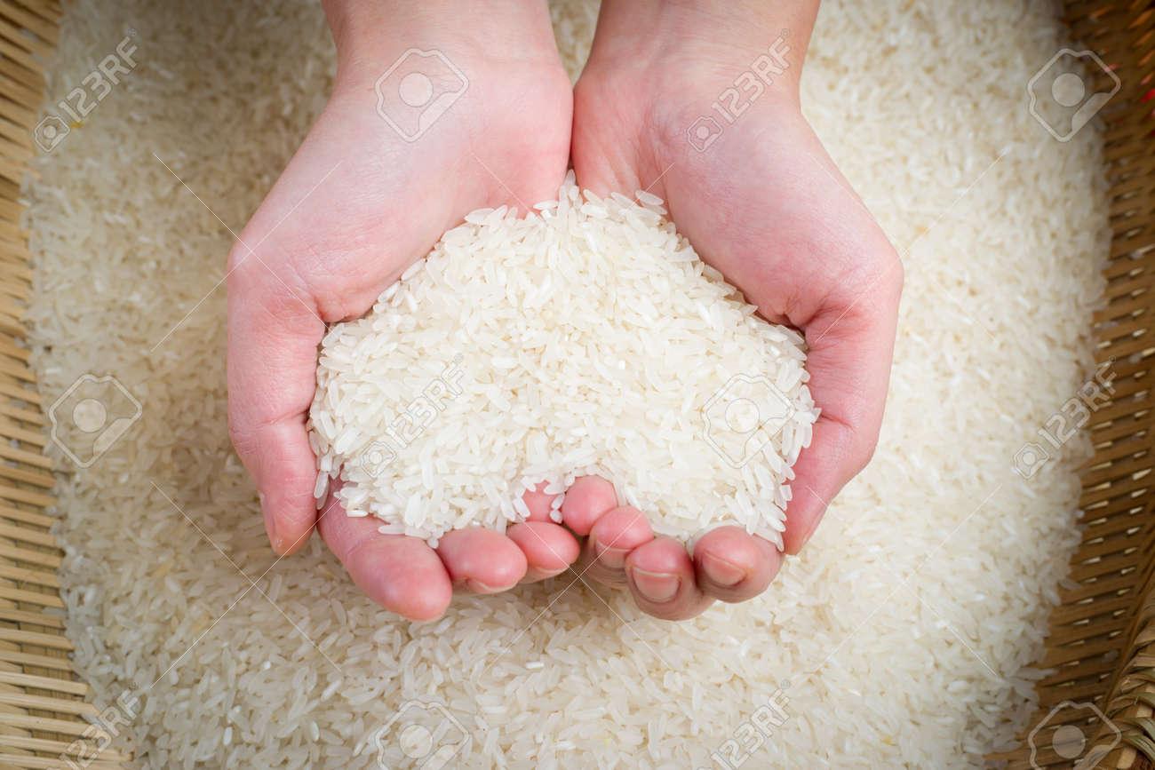 rice on hands Standard-Bild - 20023521