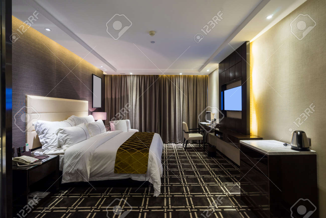 luxury hotel bedroom with nice decoration stock photo 44127507