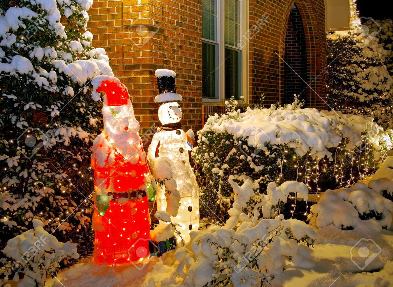 Outdoor Santa And Snowman Decorations Covered In Snow Stock Photo   11455212