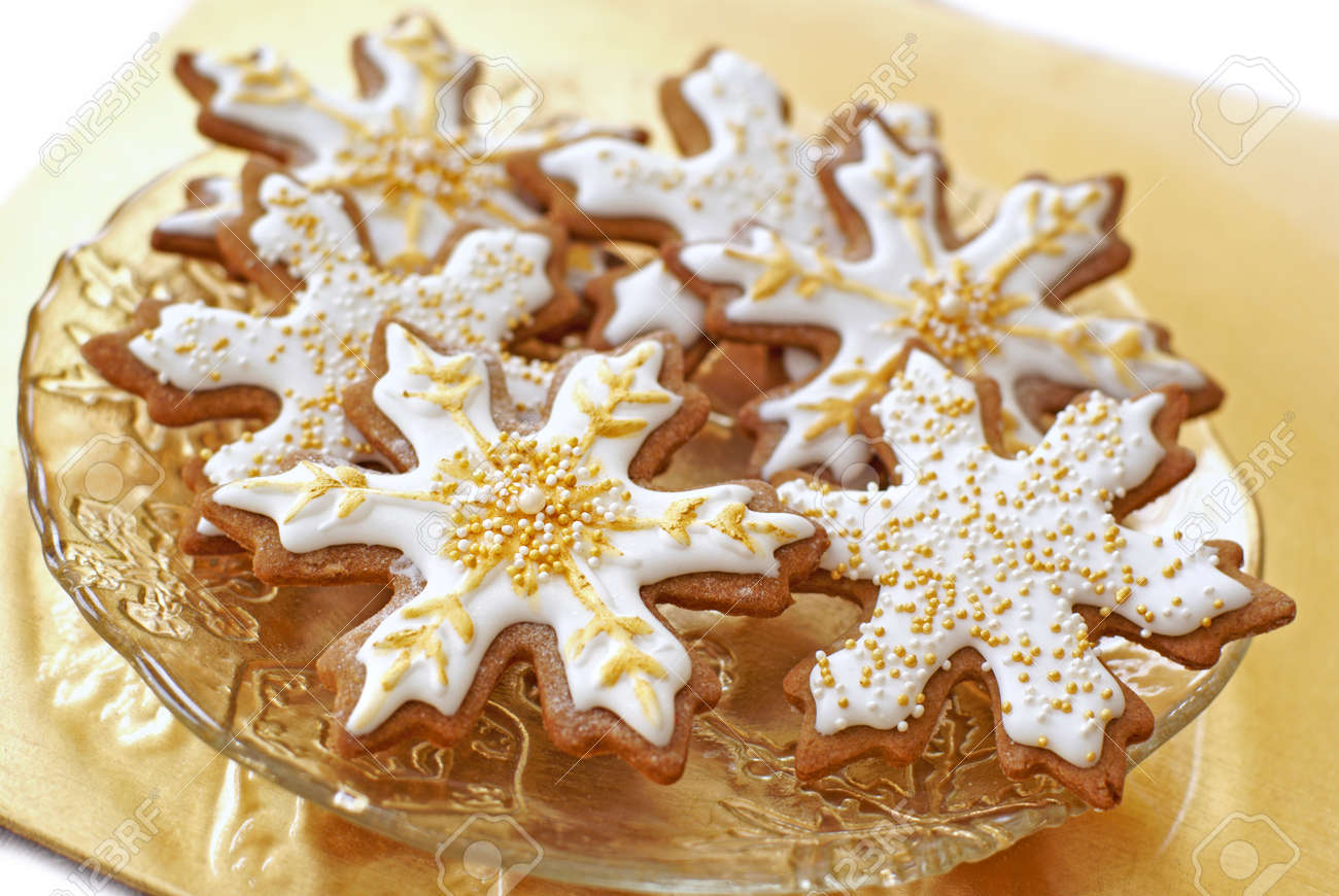 Snowflake Gingerbread Cookies Decorated With Icing Gold And