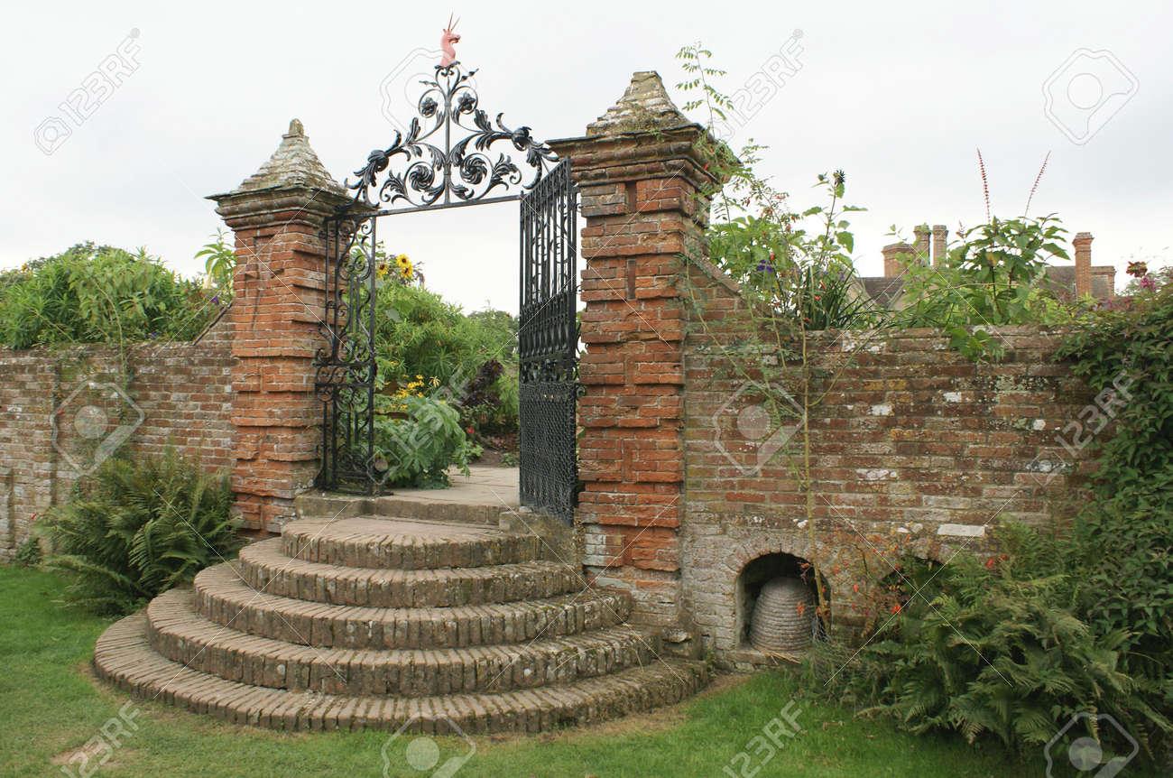 Ornate Wrought Iron Garden Gate With A Unicorn Sculpture Stock Photo ...