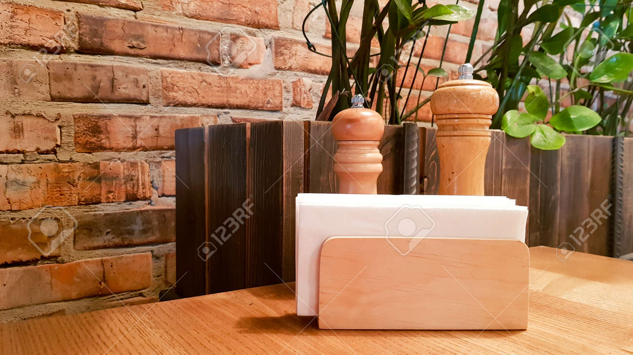 A Table In A Cafe Or Restaurant White Napkins In A Wooden Napkin Stock Photo Picture And Royalty Free Image Image 130401239