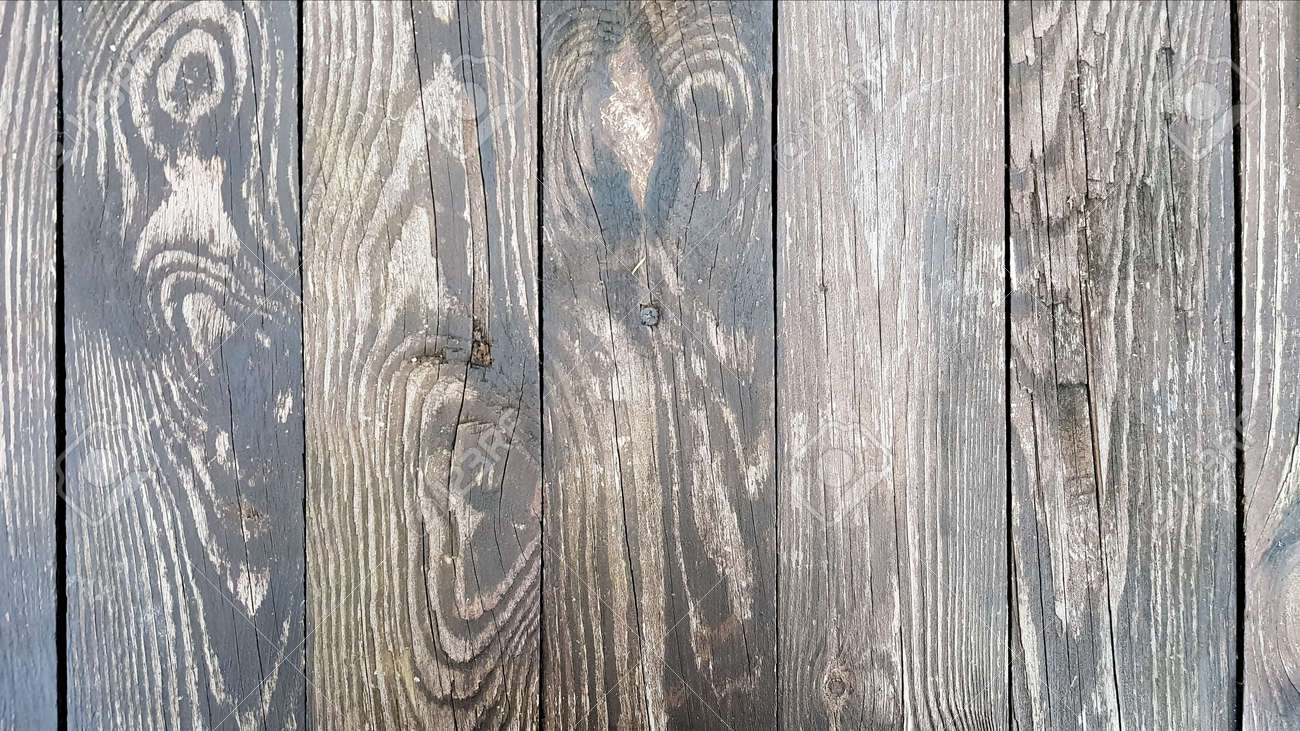 Vertical wood texture. Wooden boards. Vertical barn wood wall formwork texture. Reclaimed old wood plank. Home interior design element in a modern vintage style. Hardwood is dark brown. Close-up. - 173011104