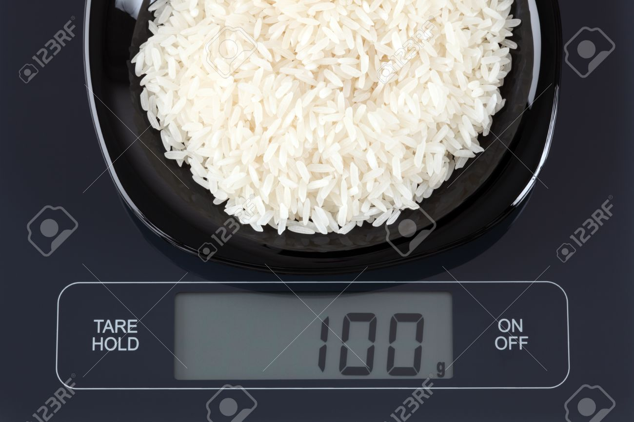 Stock P O White Rice In A Black Plate On Digital Scale Dis100 Gram