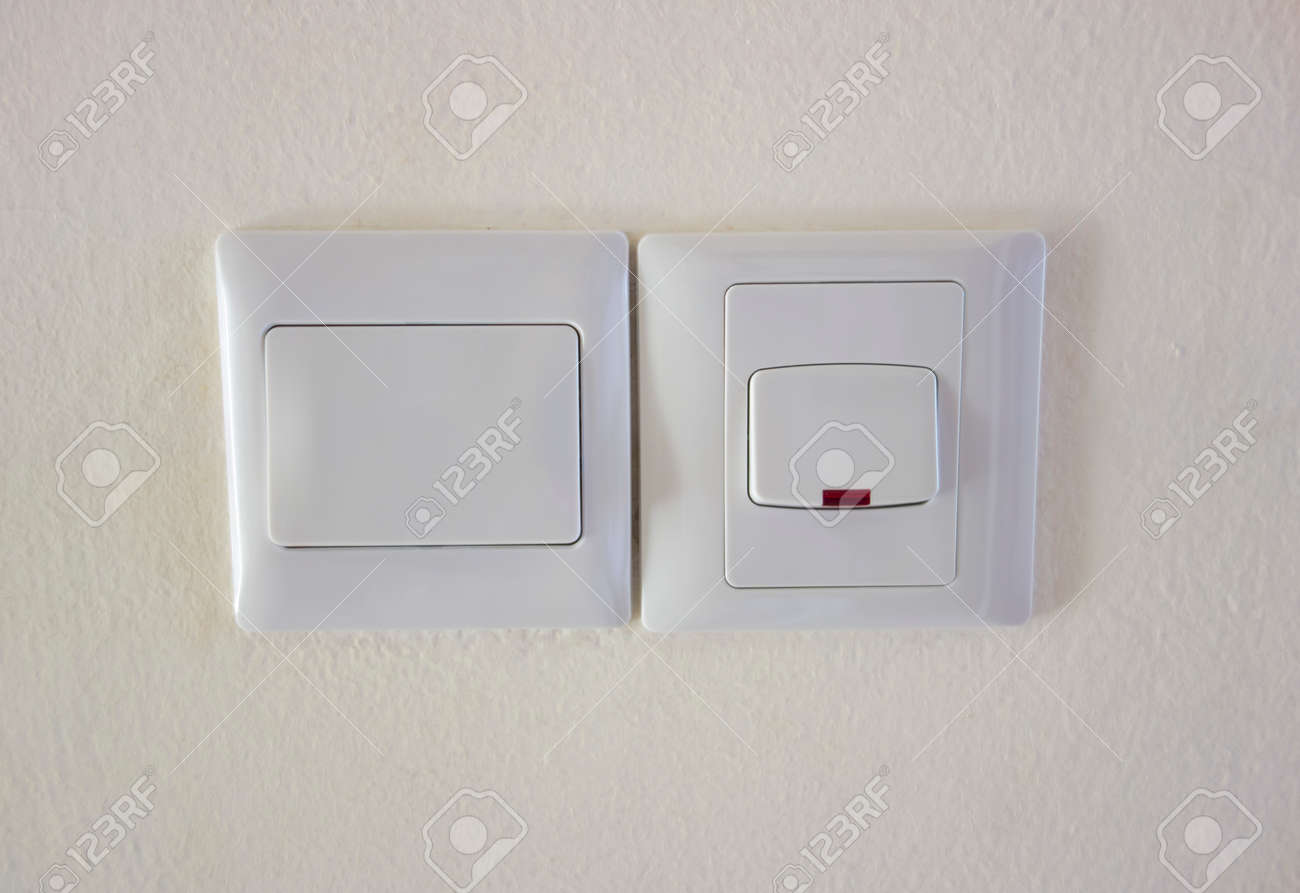 Two Light Switches In Off Position On The Wall. Stock Photo, Picture ...