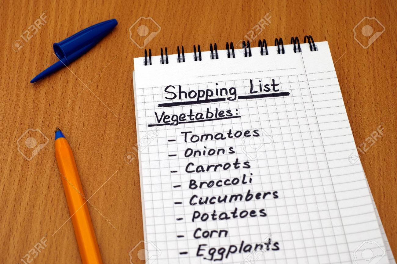 handwritten vegetable shopping list with ballpoint pen. stock photo