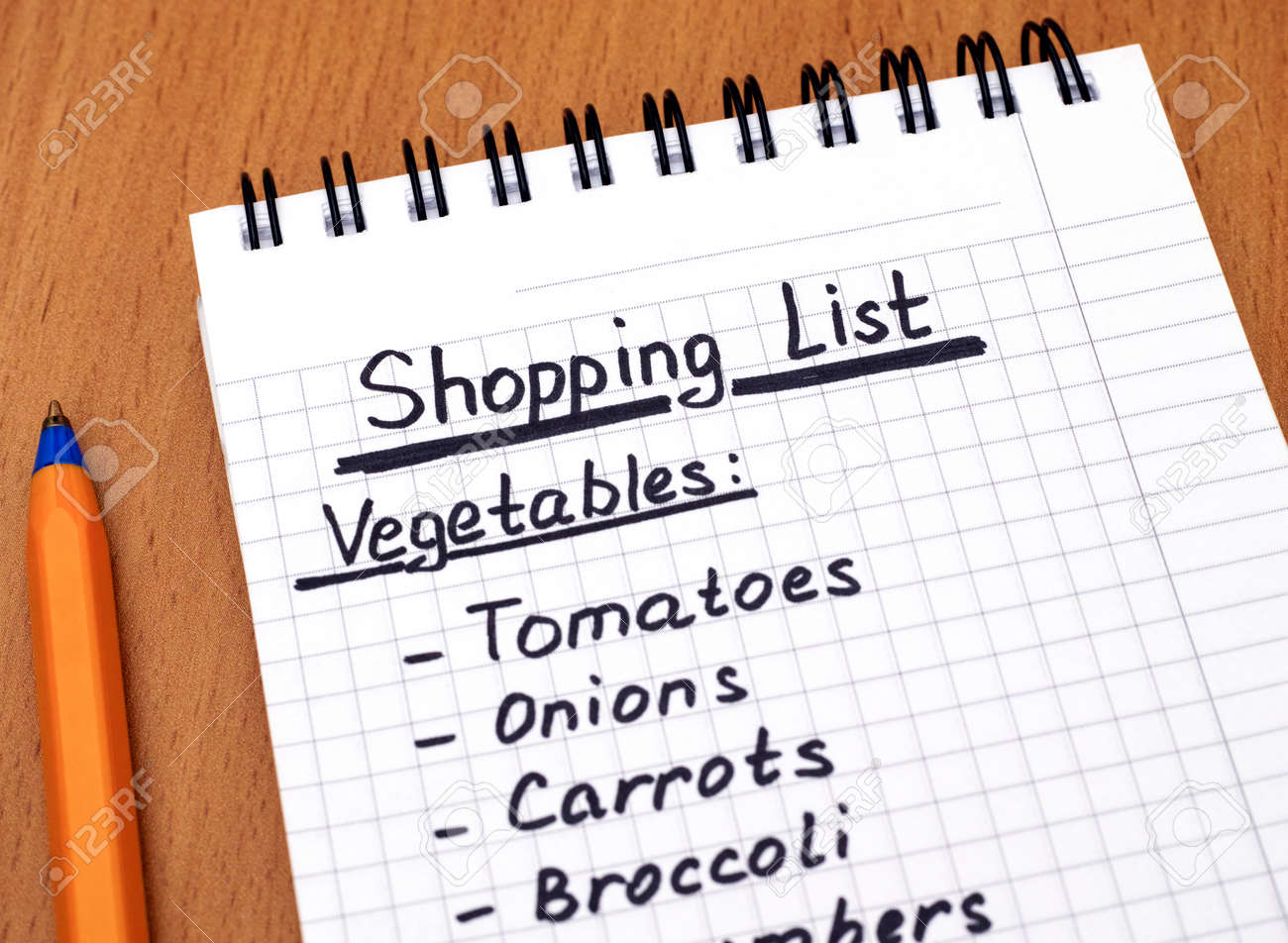 handwritten vegetable shopping list with ballpoint pen. close-up