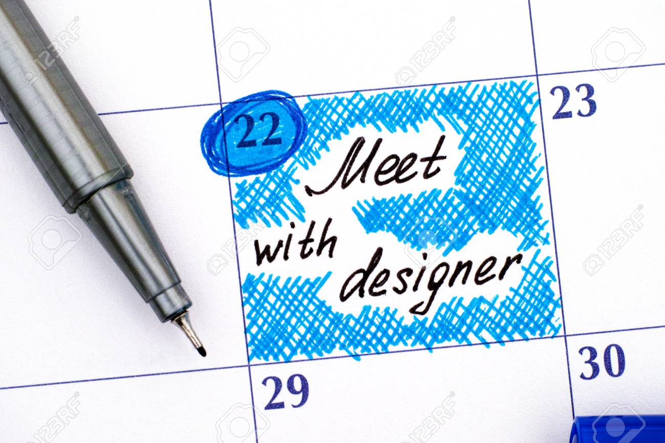 Reminder Meet With Designer In Calendar With Blue Pen Close Up