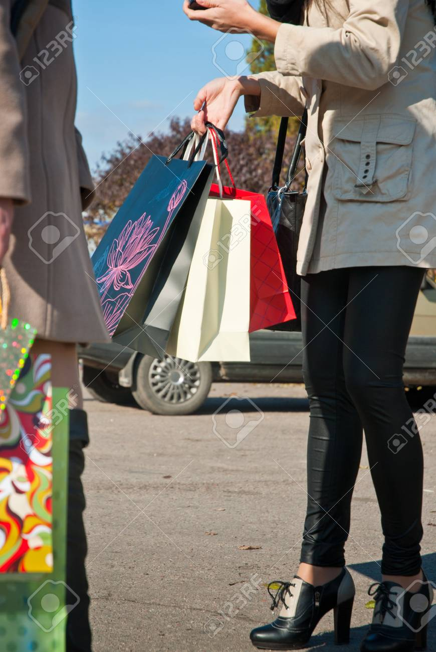 Woman with shopping bags on parking Stock Photo - 17375181
