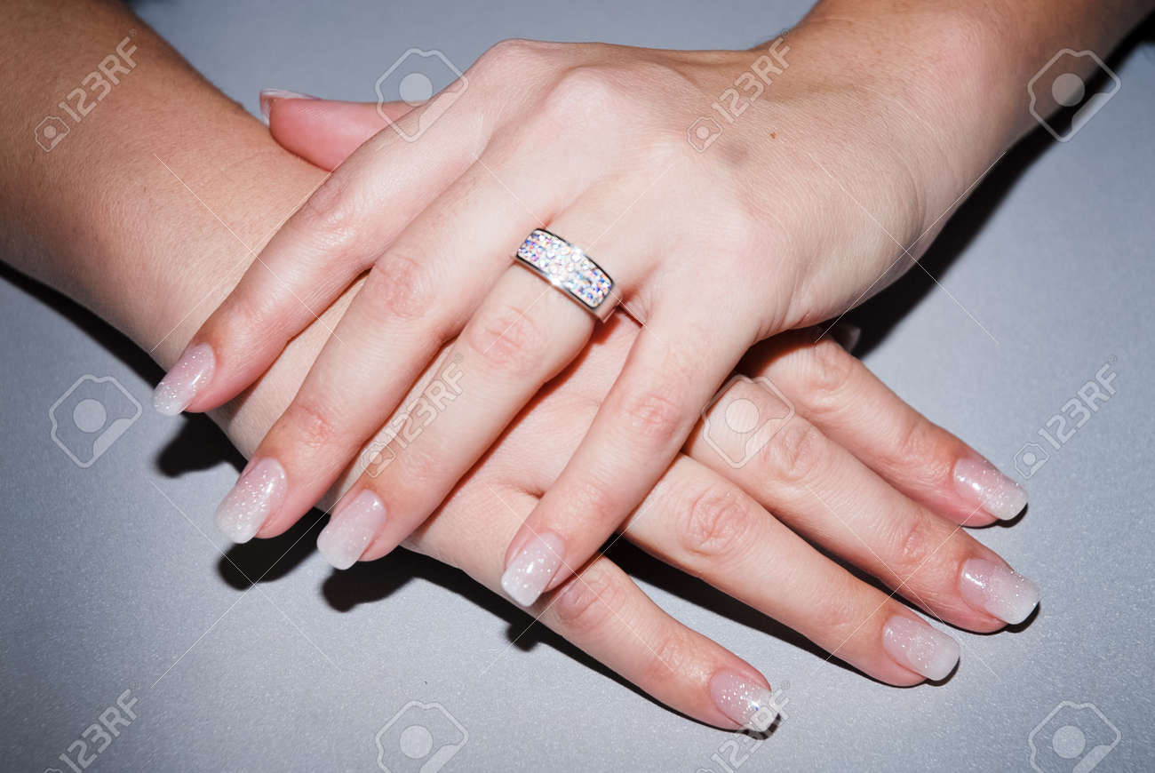 Beautiful Hands With Fresh Manicure And Diamond Ring Stock Photo ...