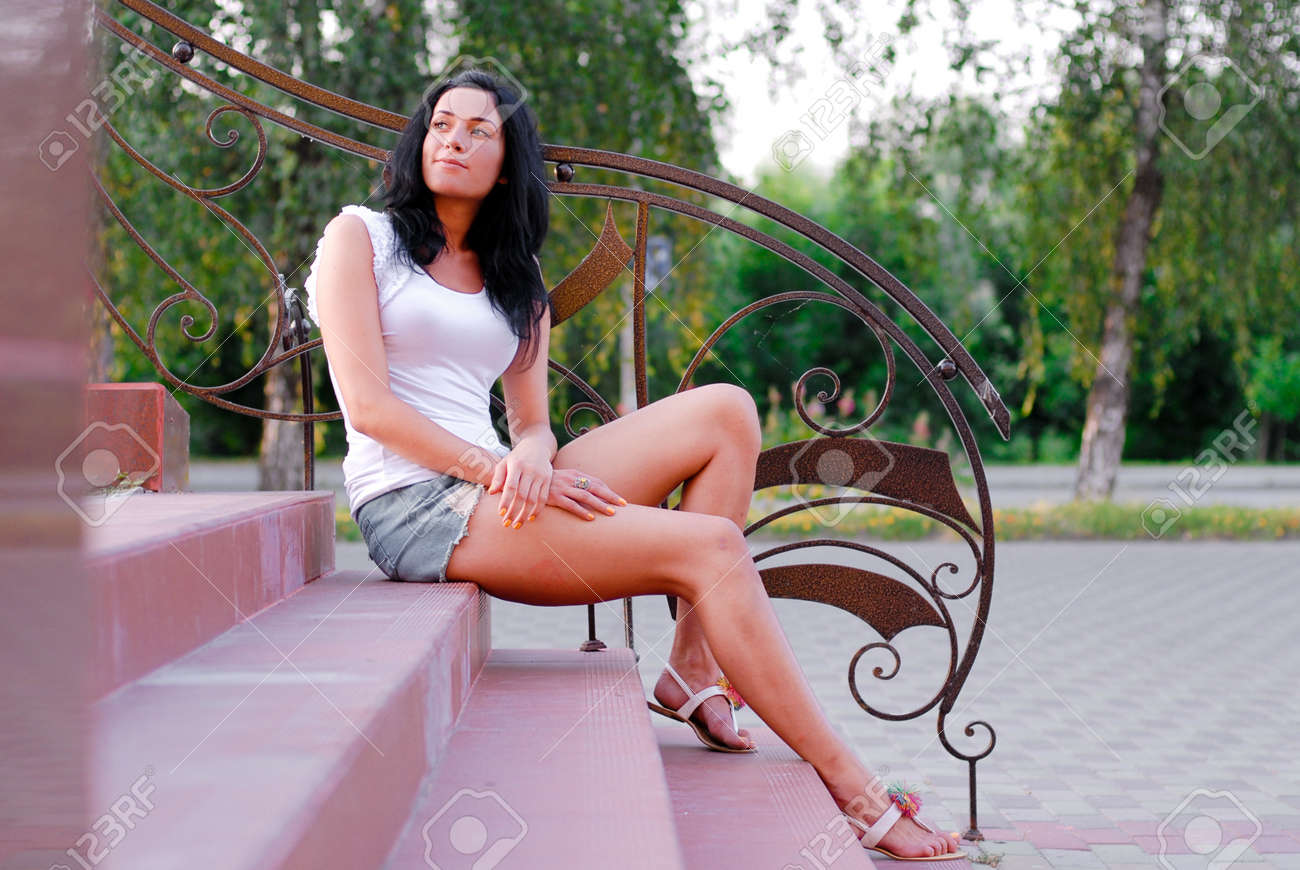 Young happy beautiful woman model sitting on stairs outdoors Stock Photo - 18024749