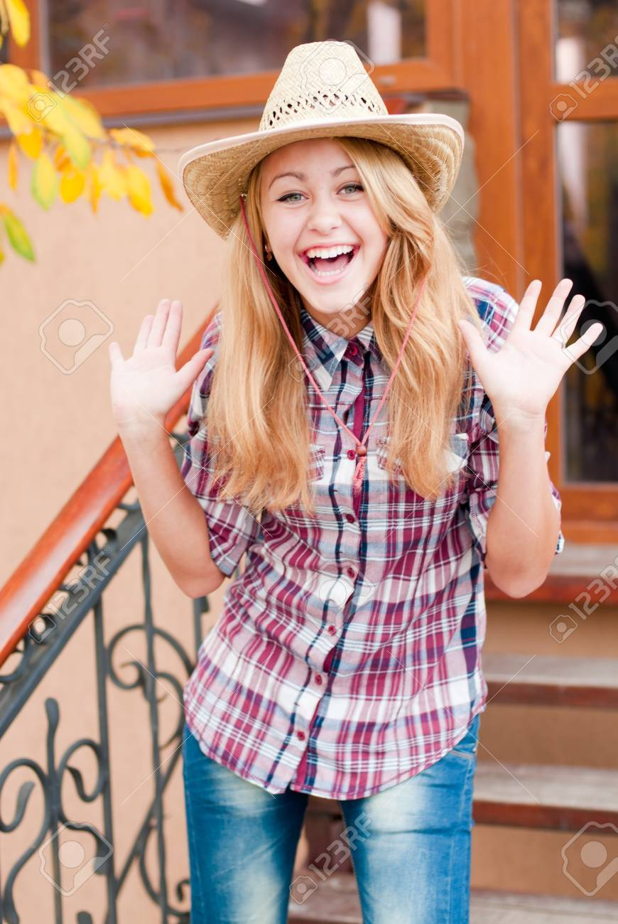 Happy young girl in cowboys hat Stock Photo - 18066914