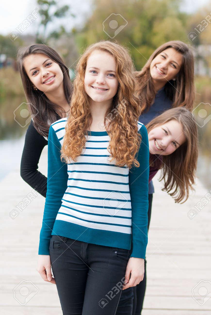 Four happy teenage girls friends - 18184601