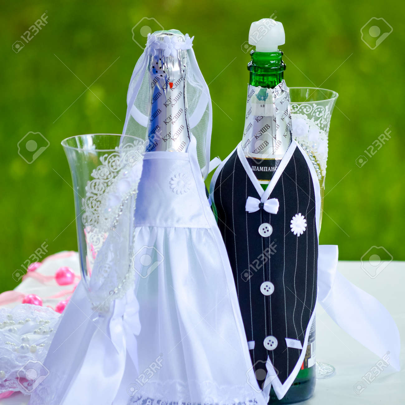Wedding Ceremony Details Of Decorated Wine Bottles Stock Photo