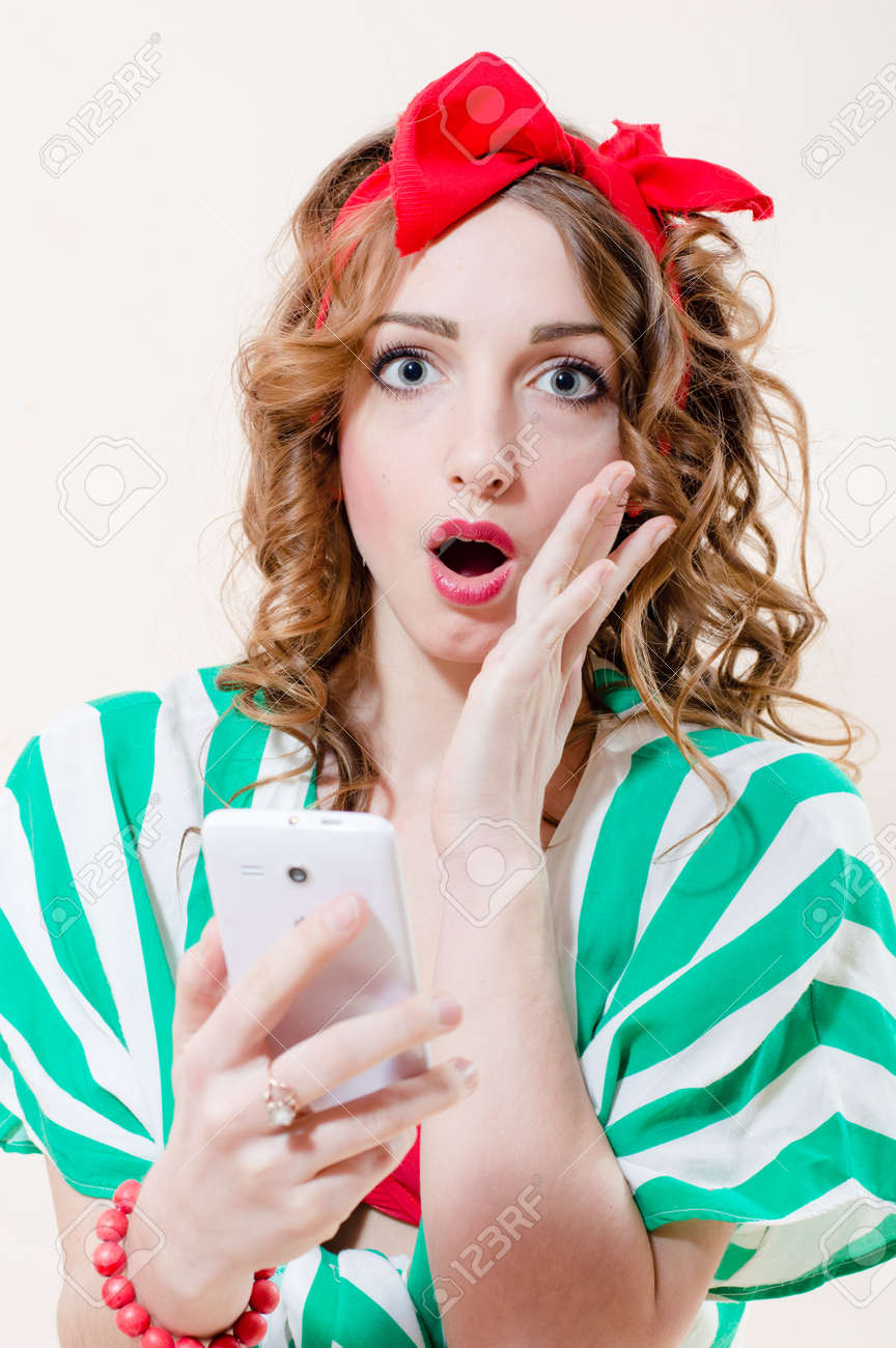 Closeup Portrait Of Shocked Holding Mobile Cell Phone Pinup Girl