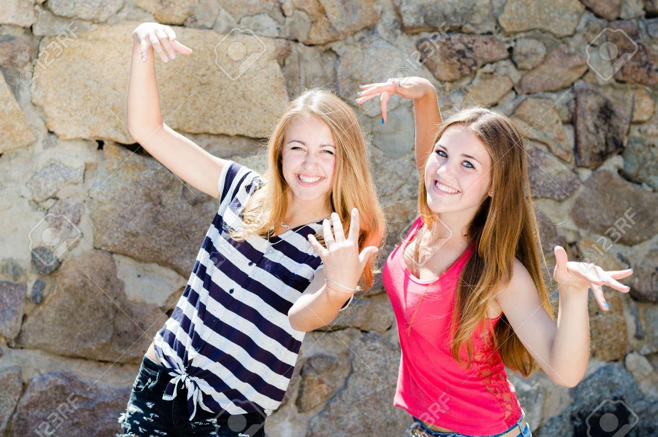 2 Funny Girls Having Fun Posing Grimacing Stock Photo