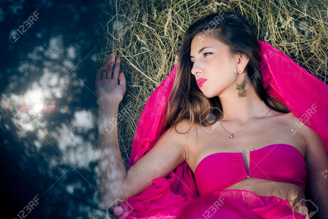 picture of sexi beautiful young lady with long hair in pink day