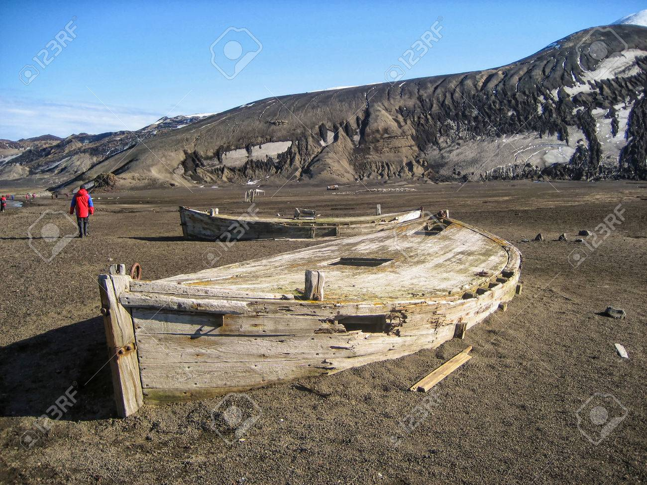 Abandoned whaling boats on Deception Island, the caldera of an
