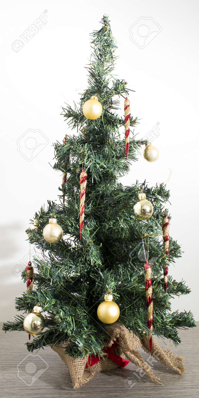 Detailed Green Christmas Tree With Red And Gold Decorations In