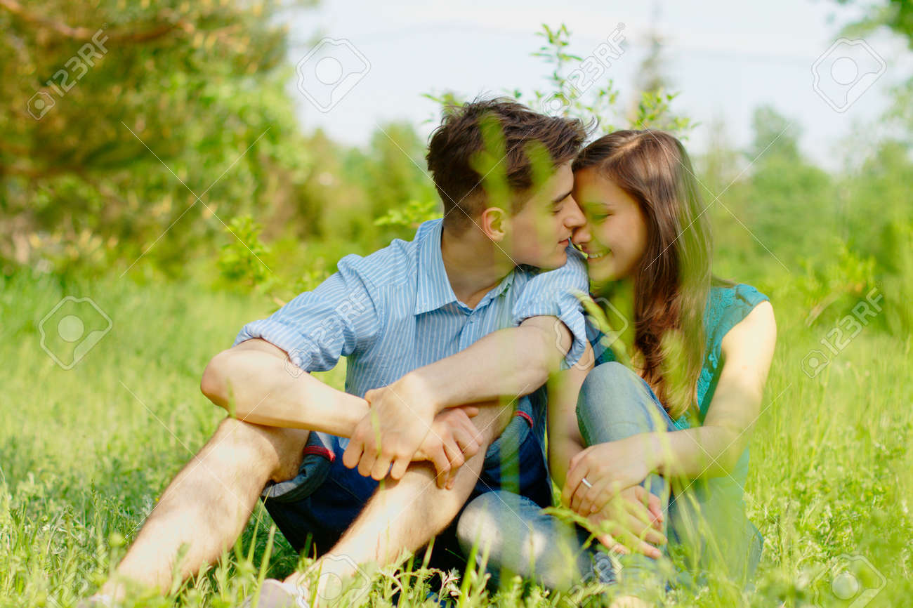romantic young couple sitting in a field Stock Photo - 9741957