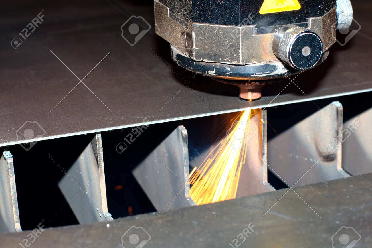 Industrial laser with sparks flyiing around (with copy space) Stock Photo - 10136164