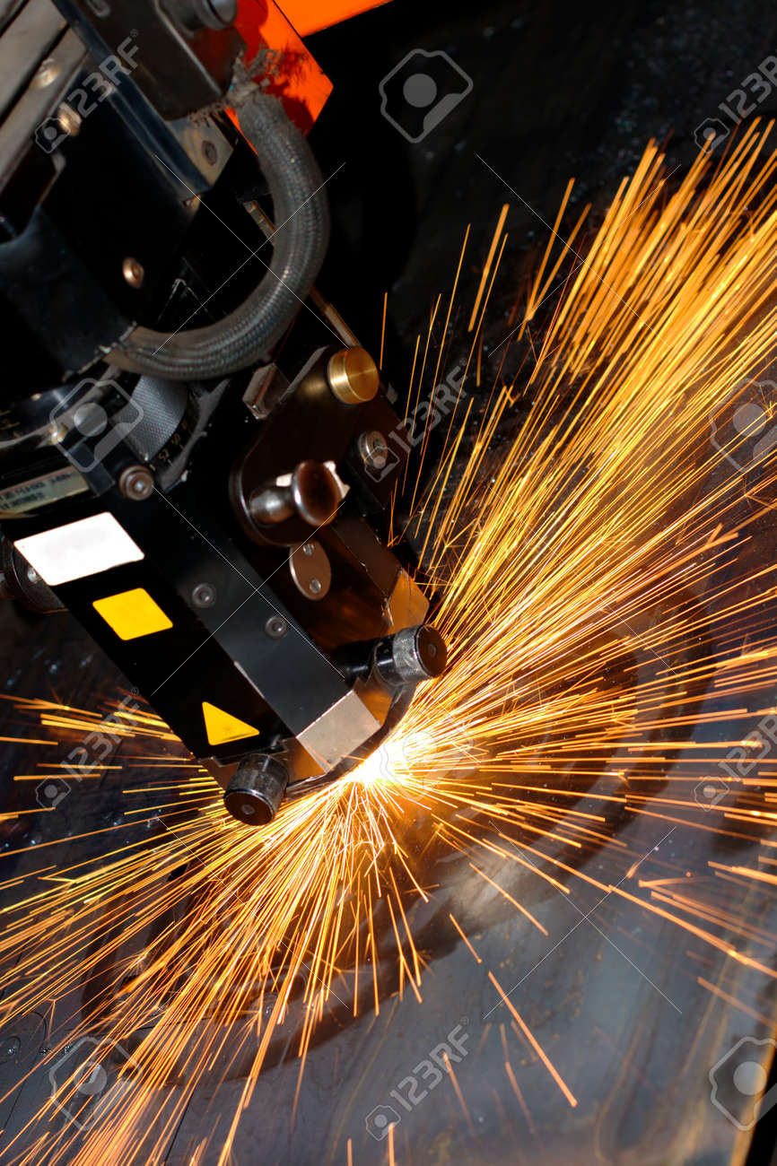 Industrial laser with sparks flyiing around (with copy space) Stock Photo - 10335682