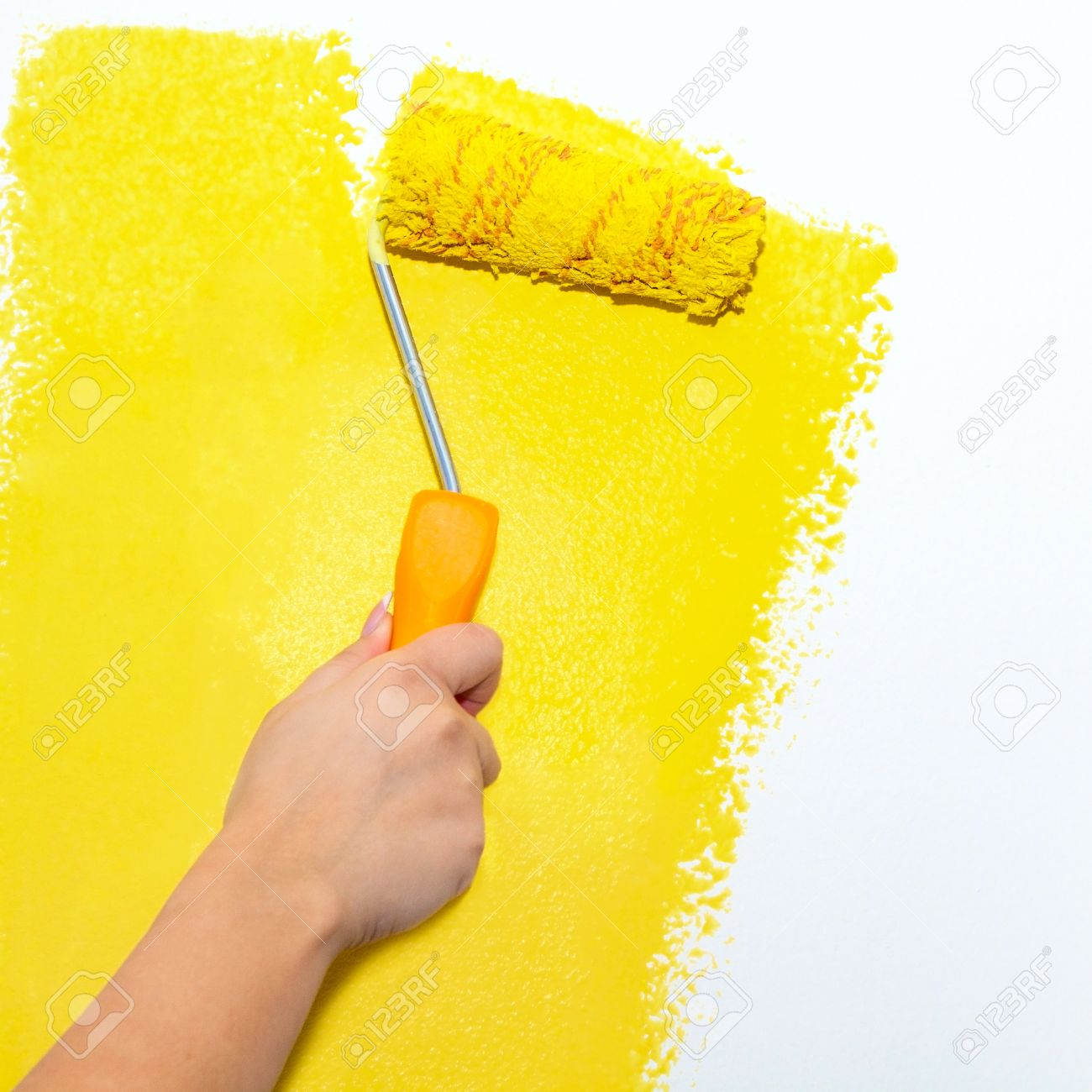 Painting Roller On White Wall With Yellow Paint Stock Photo, Picture ...