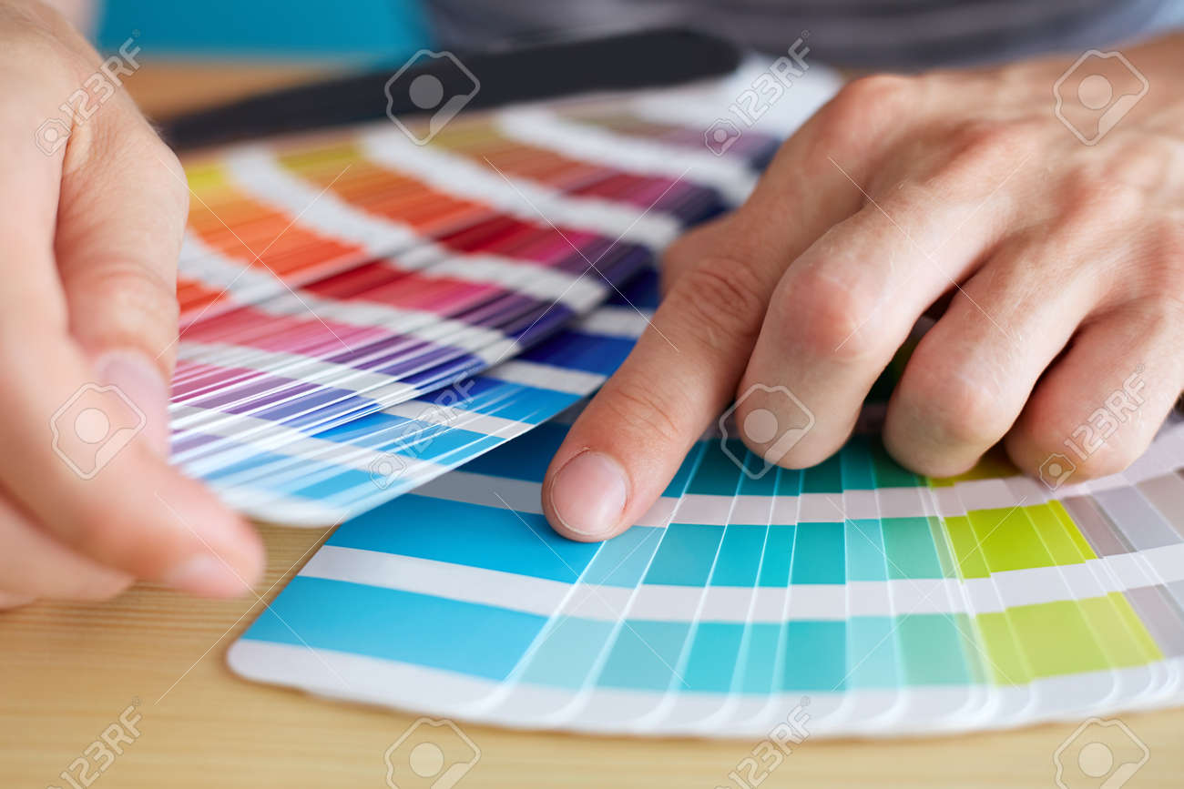 Graphic designer choosing a color from the palette - 44558355
