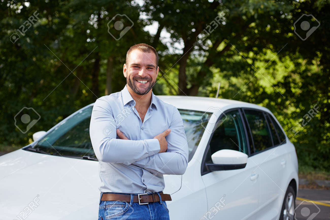 Handsome man standing in front of car Stock Photo - 44941834