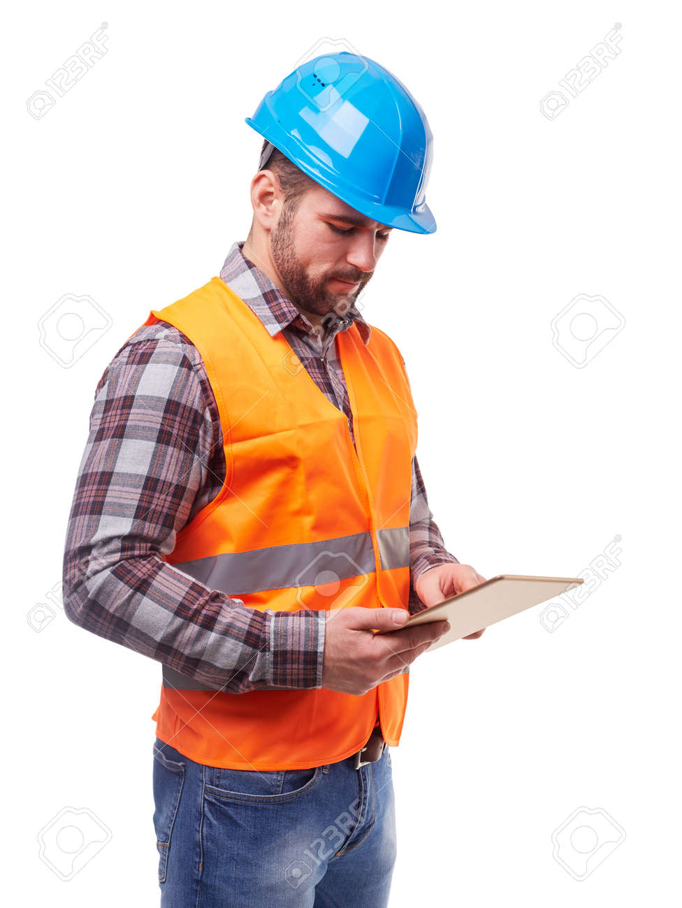 Manual worker in blue helmet and shirt using a digital tablet, isolated on white. - 57154831