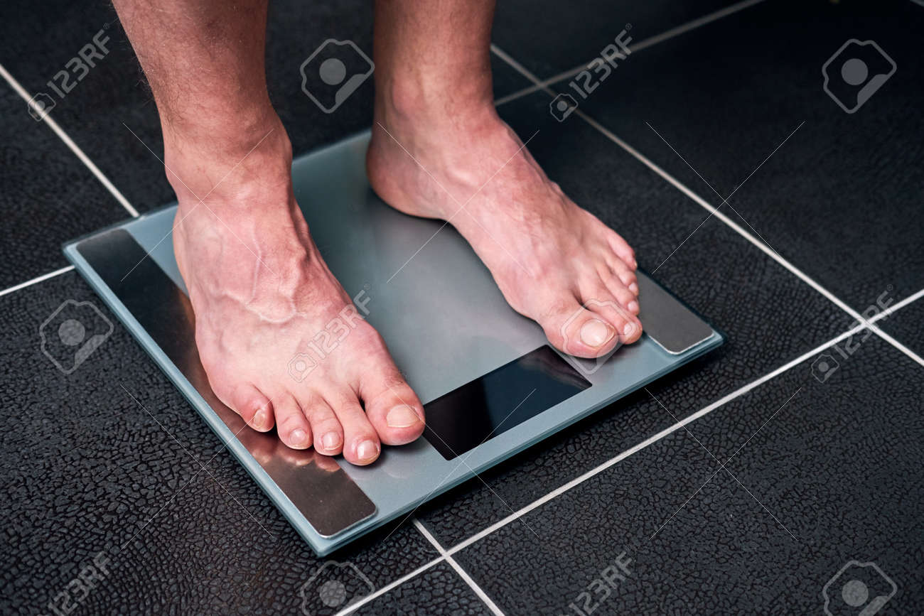 Male Feet On The Scale In The Bathroom Stock Photo Picture And Royalty Free Image Image 97042857