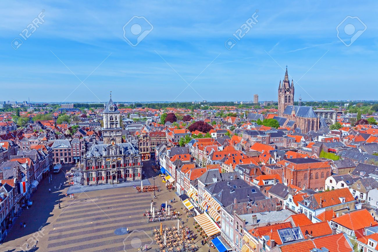 View from Nieuwe Kerk (New Church) (1383-1510) on Oude Kerk (Old Church) (14th-15th cent.), Delft, Netherlands Stock Photo - 16063466