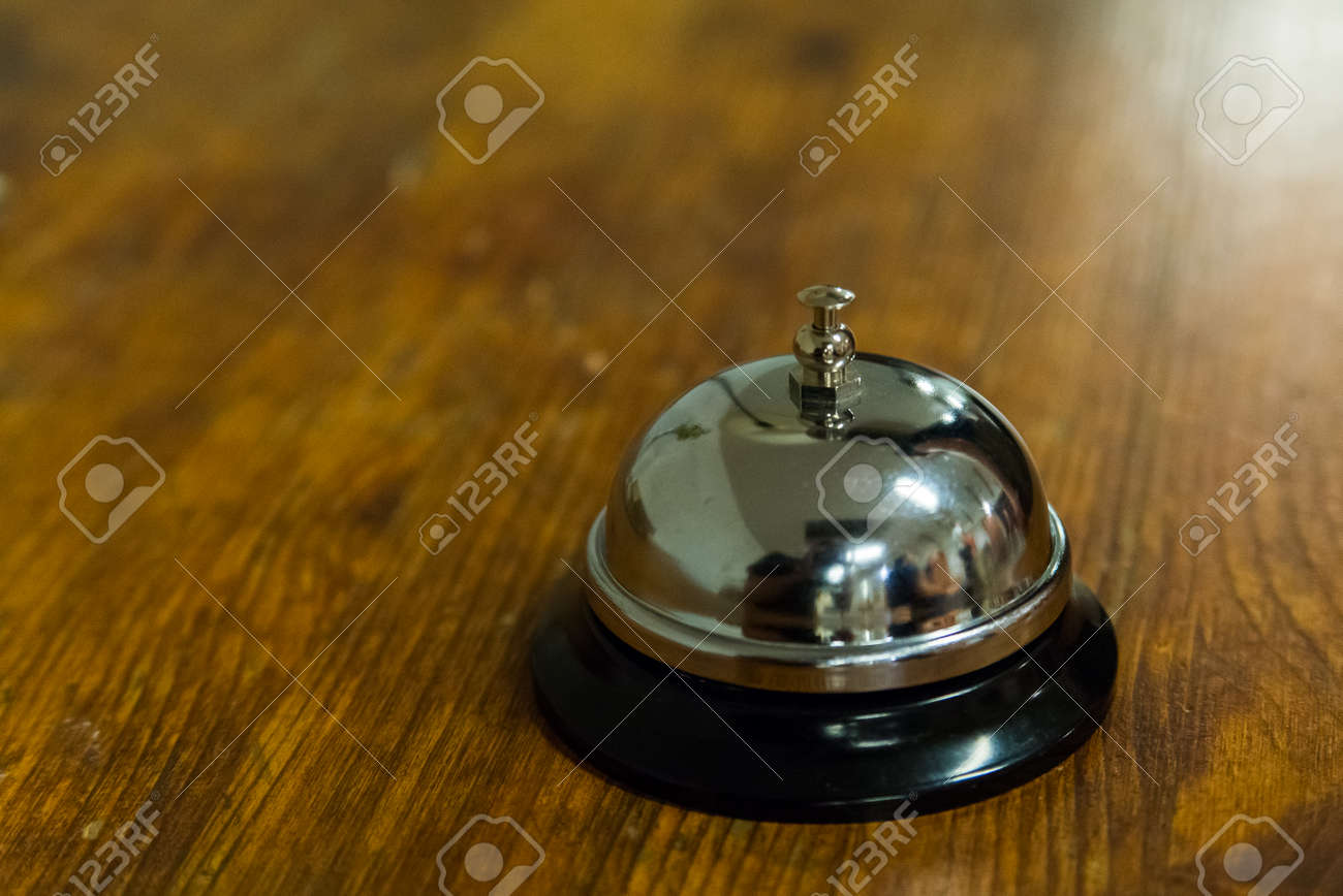 Terrific Hotel Service Call Bell On Wooden Reception Front Desk Home Interior And Landscaping Oversignezvosmurscom